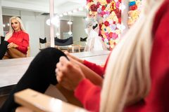 Fitness Woman Looking at Her Reflection in Mirror stock photography