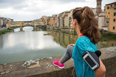Fitness woman looking on ponte vecchio in florence Royalty Free Stock Images