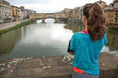 Fitness woman looking on ponte vecchio in florence Stock Photography