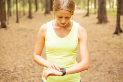 Fitness woman looking at smartwatch Royalty Free Stock Image