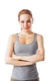 Fitness woman looking to the camera with arms crossed. Isolated on white Royalty Free Stock Photo