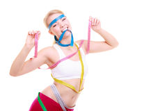 Fitness woman with a lot of colorful measure tapes Stock Photography