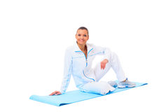Fitness woman making a break in tailor-seat Stock Images