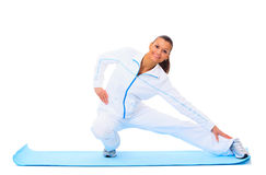 Fitness woman making a break in tailor-seat Royalty Free Stock Photo