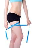 Fitness woman measure leg Royalty Free Stock Photo