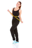 Fitness woman with measure tape Royalty Free Stock Image