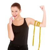 Fitness woman with measure tape Stock Image