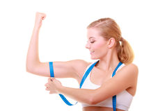 Fitness woman with measure tape measuring biceps Stock Images