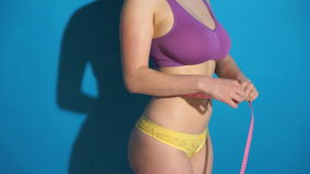 Fitness woman measuring her body Stock Photos