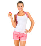 Fitness woman with a measuring tape stock photography