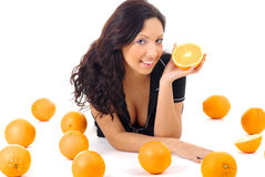 Fitness woman with orange Royalty Free Stock Photo