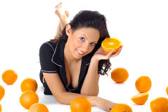 Fitness woman with orange Royalty Free Stock Images