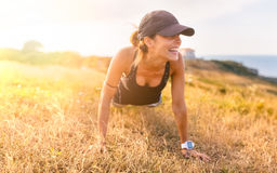 Fitness woman outdoors Royalty Free Stock Photo