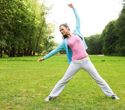 Fitness woman in park Royalty Free Stock Photos