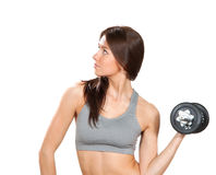 Fitness woman with perfect athletic body and abs workout Royalty Free Stock Image