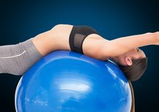 Fitness woman performing exercise using fitness ball Royalty Free Stock Photo