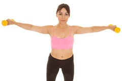 Fitness woman pink sports bra arms out with weights Royalty Free Stock Photo