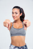 Fitness woman pointing finger at camera Royalty Free Stock Photos