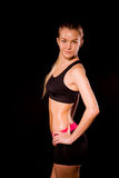 Fitness woman portrait isolated on black background. Smiling hap Royalty Free Stock Images