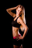 Fitness woman portrait isolated on black background. Smiling hap Royalty Free Stock Photos