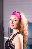 Fitness woman portrait. Smiling happy female fitness model. Fresh beautiful Caucasian sporty girl. royalty free stock photo