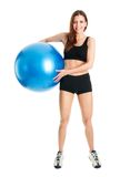 Fitness woman posing with fitness ball Stock Image
