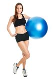 Fitness woman posing with fitness ball Stock Photos