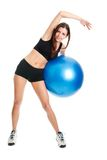 Fitness woman posing with fitness ball Royalty Free Stock Photography