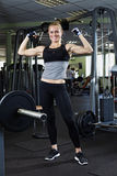 Fitness woman posing in gym Stock Photography