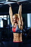 Fitness woman posing in gym Stock Images