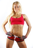 Fitness woman posing in gym Royalty Free Stock Photos