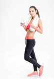 Fitness woman posing with white towel and bottle of water Stock Images