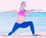 Fitness woman is practicing stretching Royalty Free Stock Photos
