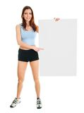Fitness woman presenting empty placard Royalty Free Stock Images