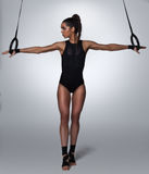 Fitness woman pulling acrobatic rings Royalty Free Stock Photo