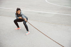 Fitness woman pulling chain for strength workout Royalty Free Stock Photos