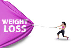 Fitness woman pulls weight loss text Stock Images