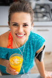 Fitness woman with pumpkin smoothie in kitchen Stock Photography