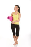 Fitness woman ready holding yoga mat. Royalty Free Stock Photos