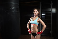 Fitness woman with the red boxing bandages Royalty Free Stock Images