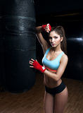 Fitness woman with the red boxing bandages Stock Images