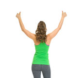Fitness woman rejoicing success . rear view Royalty Free Stock Images