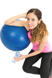 Fitness woman relaxing after exercise Stock Photography