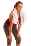 Fitness - woman rest after workout in gym with towel around her Royalty Free Stock Photos
