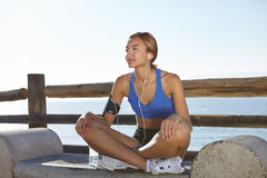 Fitness woman resting on the coastline Stock Photo