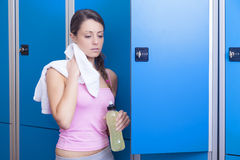 Fitness woman resting in dressing room Stock Images