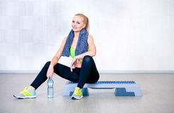 Fitness woman resting after exercises in gym Royalty Free Stock Images