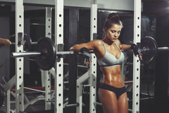 Fitness Woman resting in gym Royalty Free Stock Photos