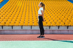 Fitness woman resting on the stadium Royalty Free Stock Photo