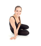 Fitness woman resting after stretching exercise Royalty Free Stock Image